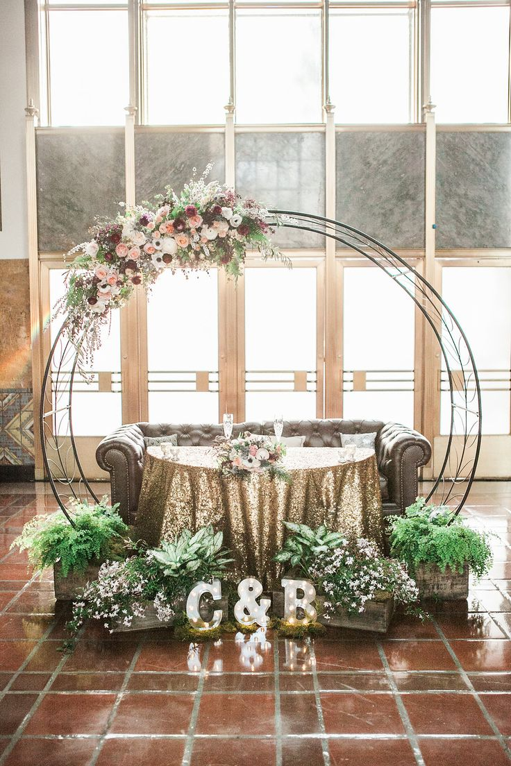 Circular Wedding Arch Re-purposed for sweetheart table - photo - Kristina Lee Photography Floral - Rebelle Fleurs Event Design