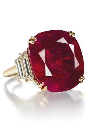 32.08 carat natural Ruby and trapeze cut diamond ring by Chaumet