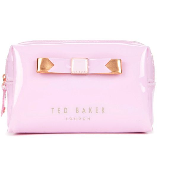 Ted Baker PIAVE Small bow cosmetic case ($31) ❤ liked on Polyvore featuring beauty products, beauty accessories, bags & cases, bags, dusky pink, travel bag, travel toiletry case, travel kit, toiletry kits and makeup bag case