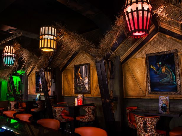 Golden Tiki — Las Vegas : This tiki bar sticks to the classics when it comes to drinks and design, but the bar shows its true Vegas style with over-the-top accents, including a talking animatronic skeleton, a secret back door, video casino games, and a calendar packed with DJs and live entertainment. Also in typical fashion, the bar is open 24 hours a day, meaning it's tiki time anytime. The cocktails range from tried-and-true classics to creative selections like a classic Martinique Ti…