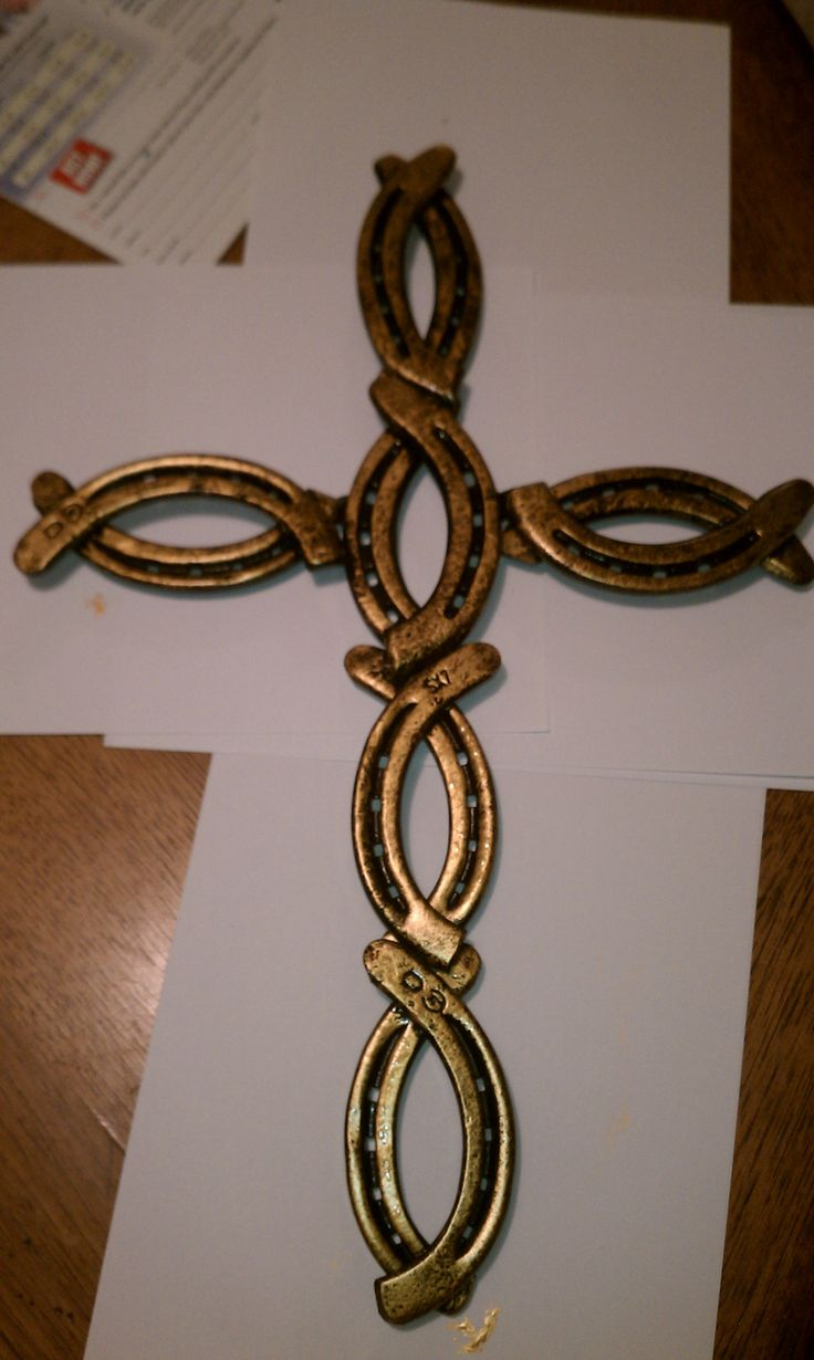 Cross painted black with gold trim