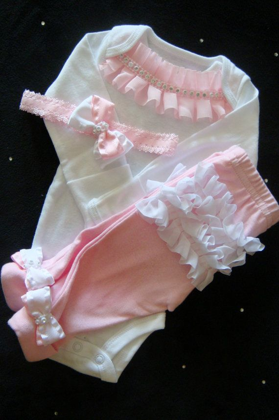 Baby Girl TAKE ME HOME outfit. Soft pink ruffles and rhinestones on the white one piece, you choose short or long sleeve. Soft pink pants have matching pink and white bow with rhinestone accent center on the cuff, white ruffles on the bottom. Matching headband has coordinating bow.  So perfect for that take home outfit!! Makes a beautiful new baby gift too:)  Everything in my shop is purchased 100% new, first quality and never seconds!! I pride my clothing on being of the utmost quality and…
