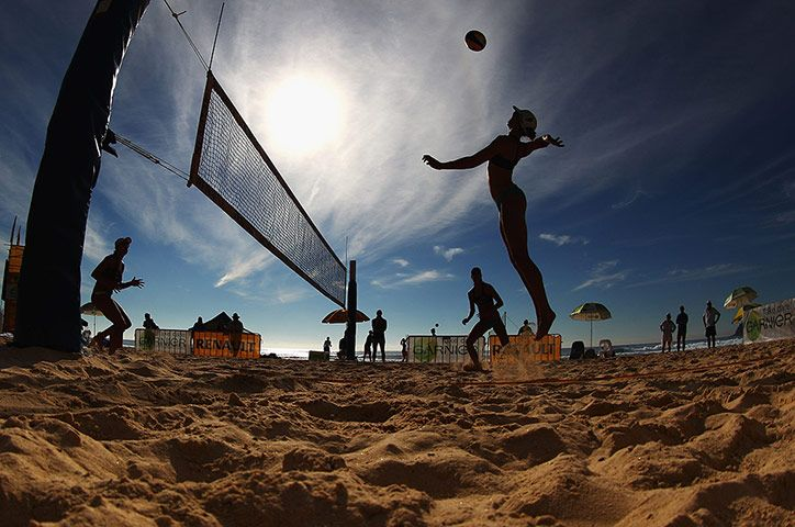 A player spikes the ball during day two of the National Beach Volleyball Series at Manly Beach in Australia  Photograph: Ryan Pierse/Getty Images