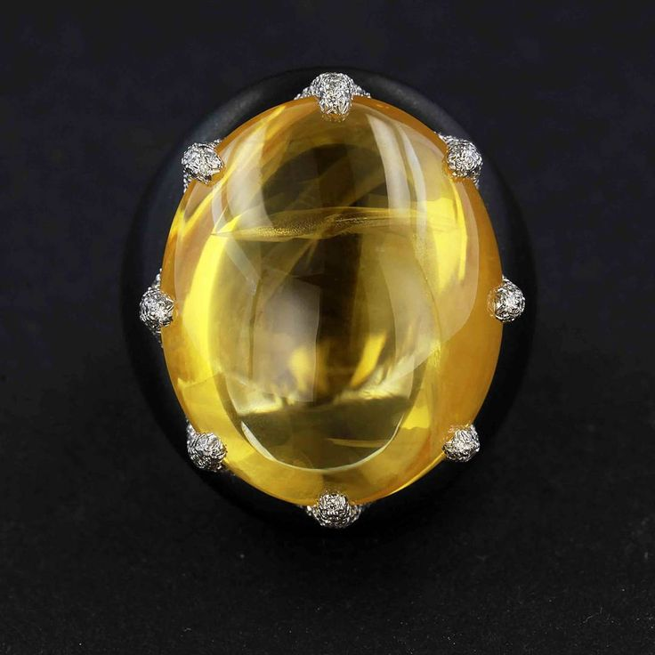 James Taffin. Cabochon natural yellow sapphire, diamond and black jade ring.