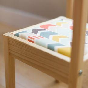See how we modified the inexpensive Ikea LATT (children's table & chair set) with cushioned chevron seats and a plexiglass table top!