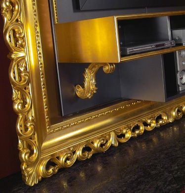 Made your entertainment room have an art touch with the Art Deco and Baroque frame style TV Media Centers from Vismara Design, This frame will give a luxurious sight for your TV stand. Available in metallic tones of silver and gold. This frame can be used for CD and DVD storage, Enhance your Entertainment room and make your friend be carried away with the daring Art Deco and Baroque frame style wall racks from Vismara Design.