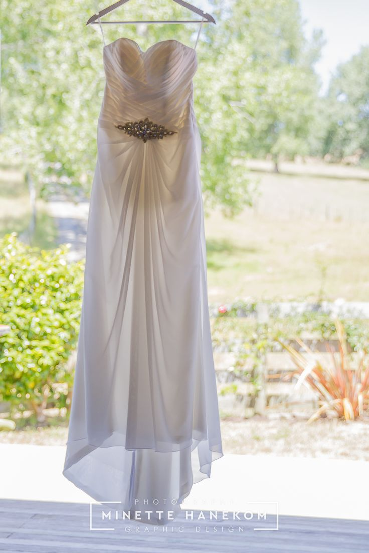 Tracey is wearing Bridal and Ball BI1-1401. A simple yet stunning and very elegant strapless chiffon gown with a lace up back. Thank you Tracey for sharing your beautiful photos of your Feb 2017 wedding with us. Photographer Minette Hanekom