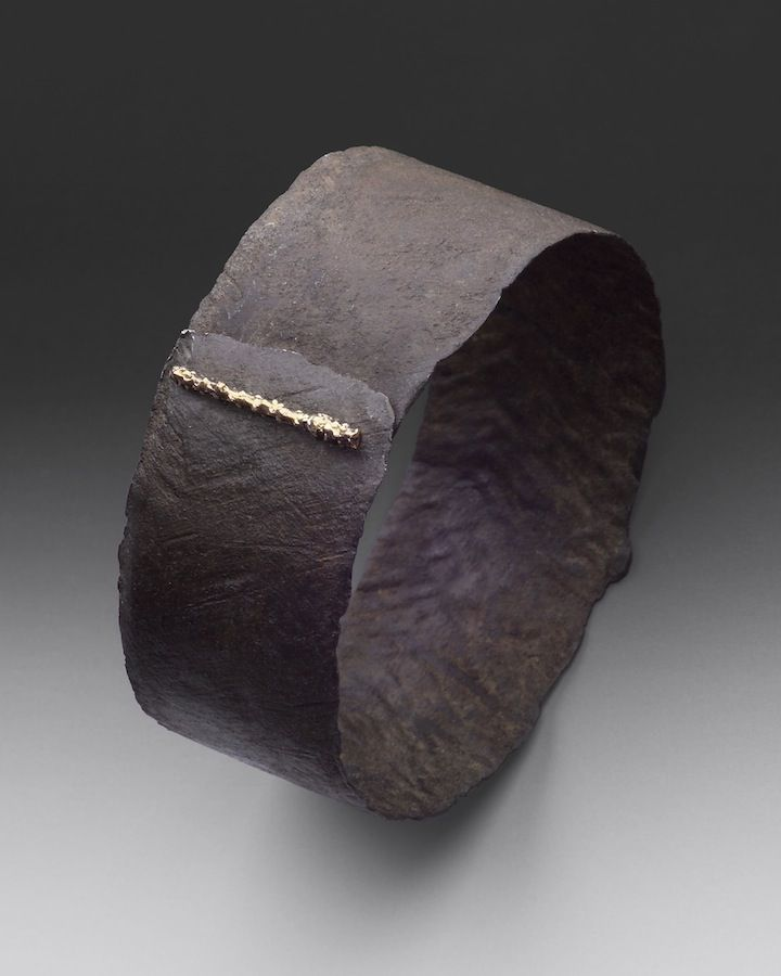 Cuff | Jaclyn Davidson.  Hand forged weathered carbon steel with 18k gold and 4 diamonds.