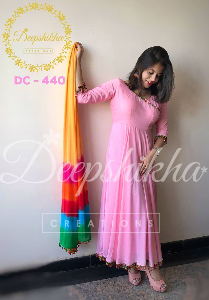 DC 440. Beautiful plain pink anrakali with tassels and colourful dupatta. Dress has tassel design with 3/4 sleeves attached with colourful tassels and border also with colorful tassels and multicolor dupatta. For queries kindly WhatsApp : +91 9059683293 16 November 2017