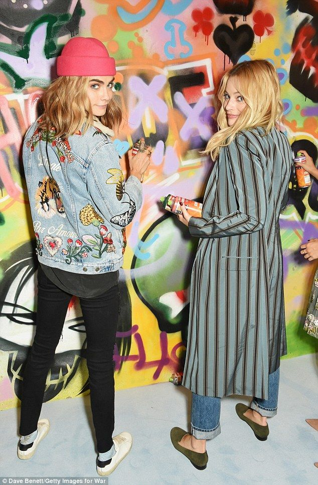 Creative: Cara Delevingne and Margot Robbie cut cool figures as they joined their Suicide Squad co-stars to put the finishing touches to graffiti artist Ryan Meades' mural