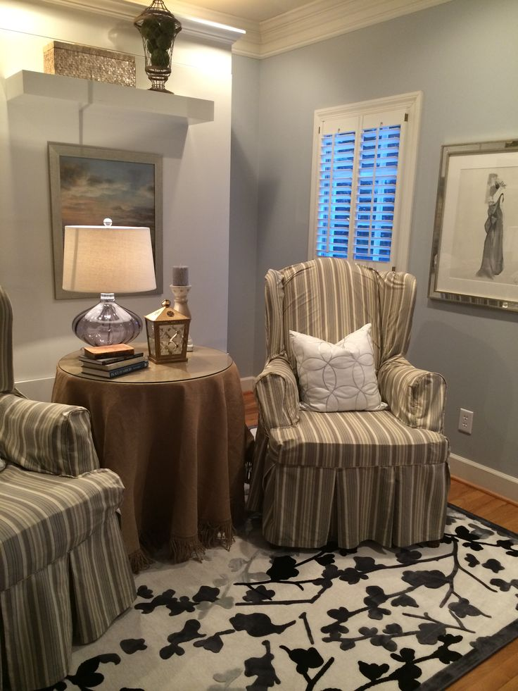 Lazy Gray by Sherwin Williams in my sitting room.
