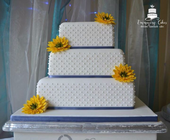 Handmade Gerbra daisies on a square polka dot wedding cake. More at www.facebook.com/emmazingcakes