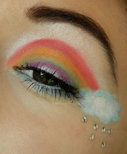 cute rainbow dash inspired makeup. from the my little pony line, this rainbow is beautifully accented with crystal teardrop rhinestones, complete with raincloud. finish off with rainbow lip stain or a plum-pink shade or ya know... whatever floats your boat :)