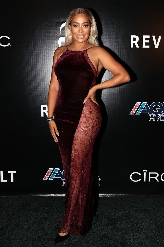 fe46a303e56d2 Lala Anthony in a sheer cutout velvet red dress
