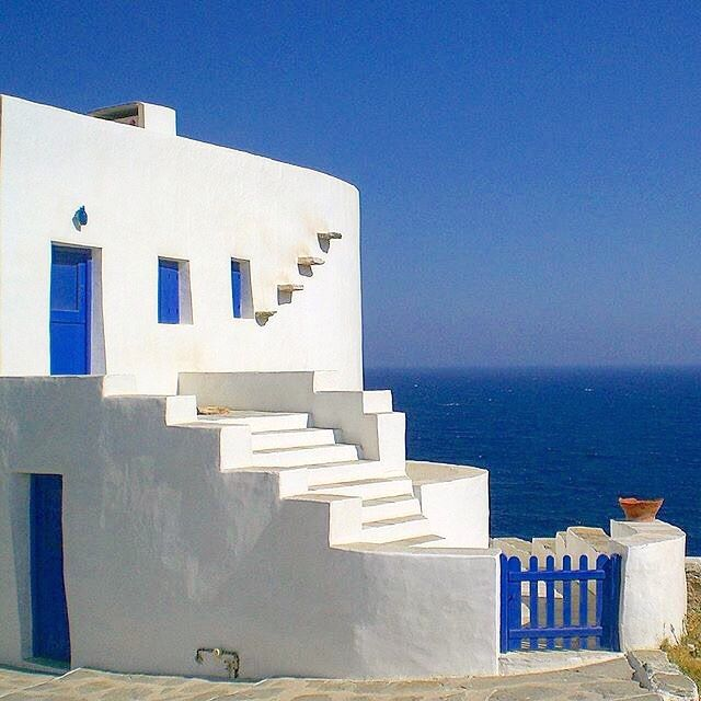 Amazing sample of the Cycladic architecture at Kastro village , in Sifnos island ( Σίφνος ) . The perfect White & Blue with the stunning view of the Aegean deep blue sea !!