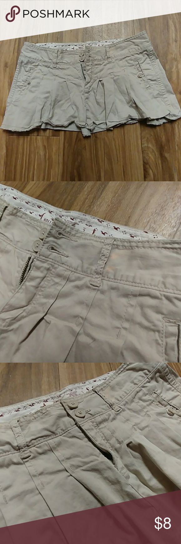 Hollister Skirt Never worn by me as its too big.[I'm a 00/0]  Tan Pleated Hollister skirt One barely noticeable stain right next to belt loop. Can easily be covered with tank top or shirt.  Has 2 pockets Buttons and zipper both fully functioning well. Hollister Skirts