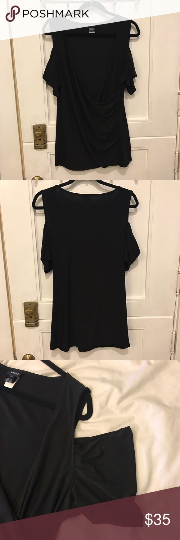 Black Cold Shoulder Top Super flattering black cold shoulder top! Front of the top crosses to a deep v-neck. Material is sturdy an flexible to smooth out your stomach and back area! Never been worn, but took the tags off! torrid Tops
