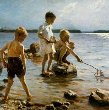 leikkiviä poikia rannalla