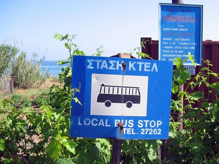 Bus stop sign on the beach road at Ormos Marathokambos on the Greek island of Samos