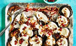 Aubergine slices with pomegranate, yogurt and tahini.