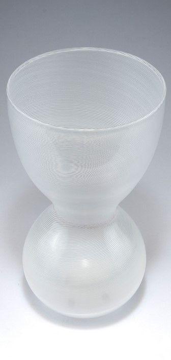 Carlo Scarpa. 'Mezza filigrana' vase, c1946-48. H. 31 cm. Made by Venini & C. Clear glass, applied white threads. Marked: venini murano ITALIA (acid stamp).