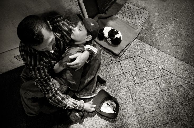 Homeless man with child and puppy