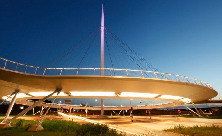Hovenring - Eindhoven, The Netherlands (2012);  a circular  pedestrian and bicycle bridge with a 230 feet tall pylon, and 236 feet diameter;  designed by ipv Delft