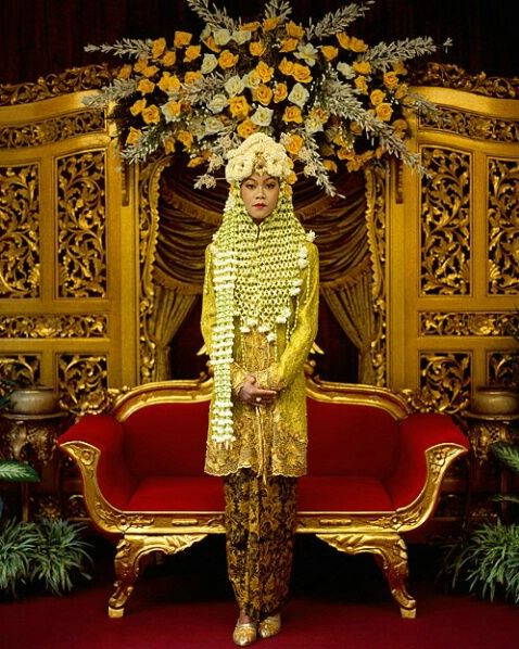 Indonesia ~ Blitar | Javanese bride in handwoven live flowers, the young lady is wearing a chest piece as well as a head covering of hand-sewn live flower petals.