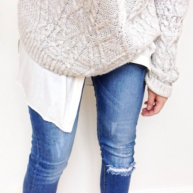 cable knit sweater + white blouse + ripped denim.