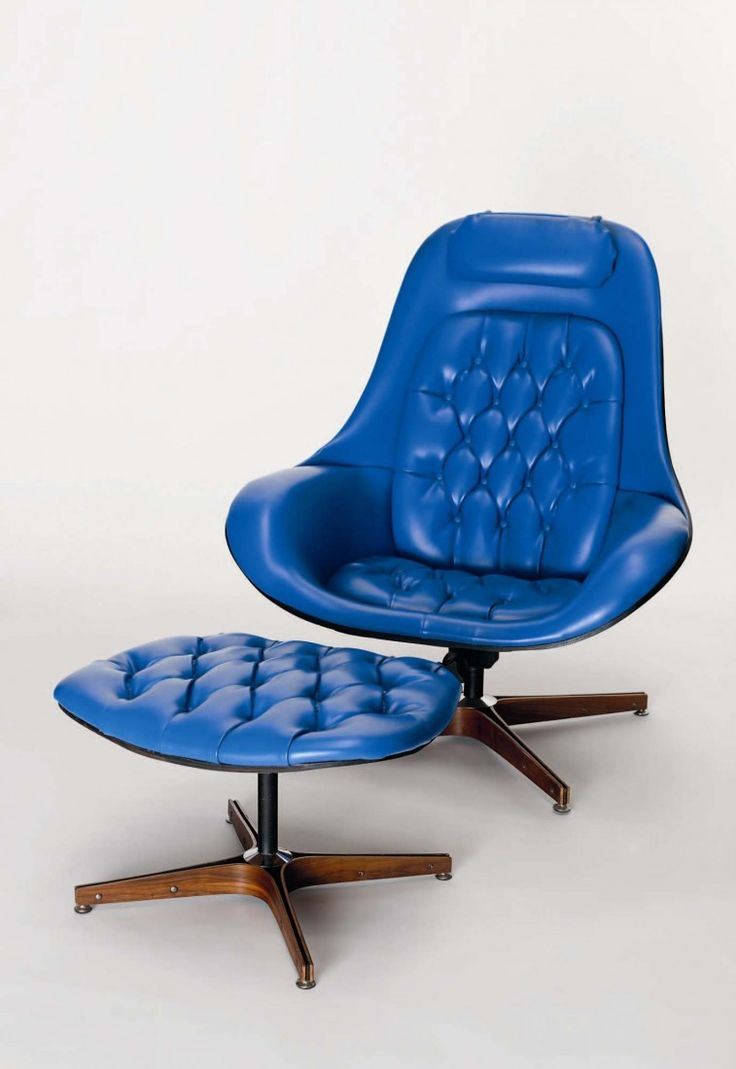 American mid century 'Plycraft' Lounger and ottoman with rare original blue leather upholstery and laminated walnut frame. Swivel and reclining base.