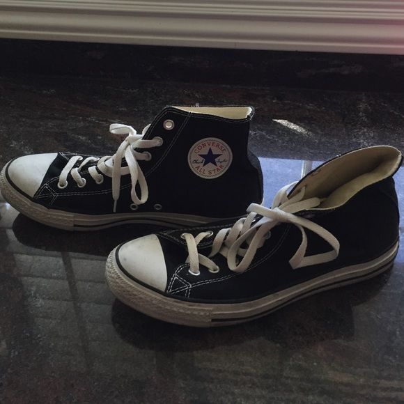 Unisex high top black Converse tennis shoes Men's size 10. Woman's size 12. Unisex high top black Converse tennis shoes. Great condition. Worn only twice. New laces. No tears! Converse Shoes Sneakers