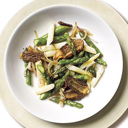 Wild foraging in Iowa! Morel mushrooms, sautéed in white wine and garlic with early spring asparagus. OMG.