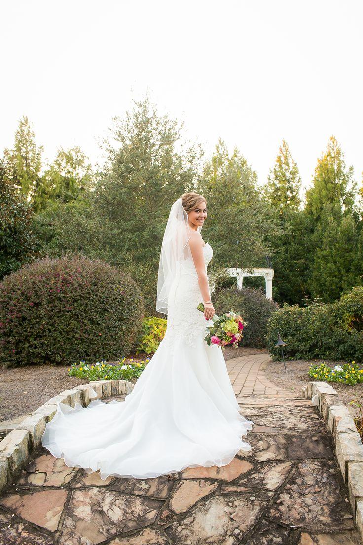 Landmark Bride, Gabby, on the stone bridge overlooking the koi pond at her November wedding. Photo Credit: Krista Joy Photography