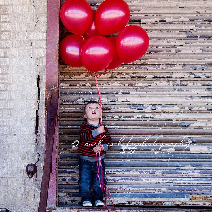 Birthday photo. Hold the number of balloons for their age!
