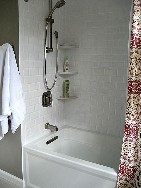Beveled White Subway Tile Shower and the tub and the shower curtain