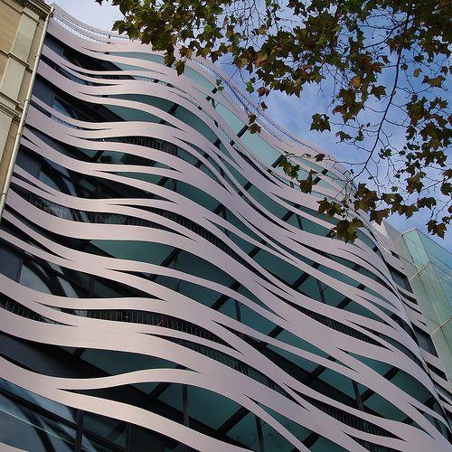 Barcelona, Passeig de Gràcia, 83.  Commercial Building, Hotel and Store.  Facade designed by Toyo Ito.