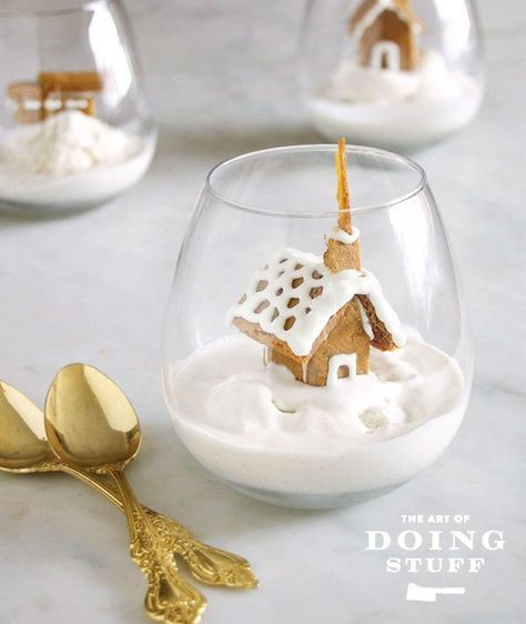 Tiny gingerbread house dessert on ice cream.