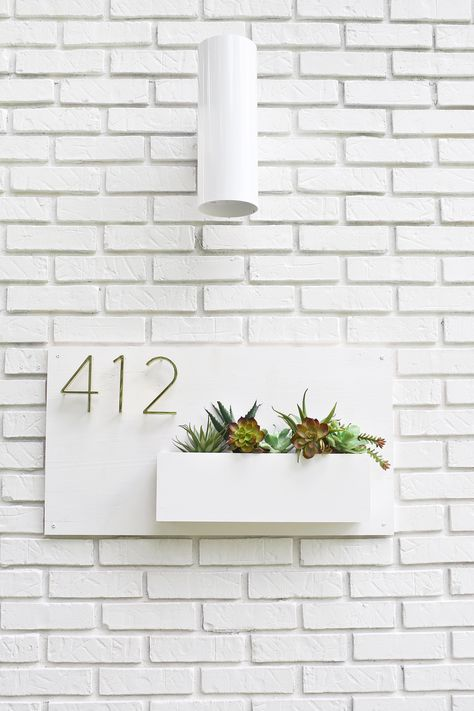 Modern house numbers and planter