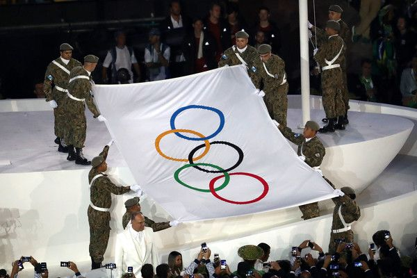 The Olympic flag is presented during the Opening Ceremony of the Rio 2016 Olympic Games at Maracana Stadium on August 5, 2016 in Rio de Janeiro, Brazil.