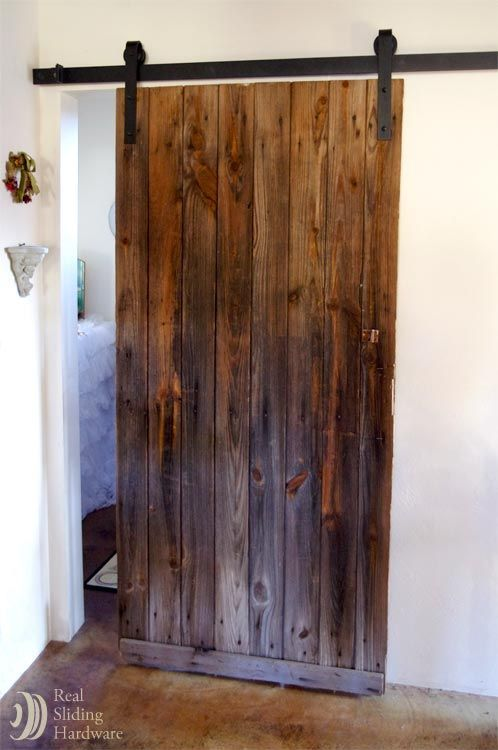 reclaimed barn door in a retail location for the home basement