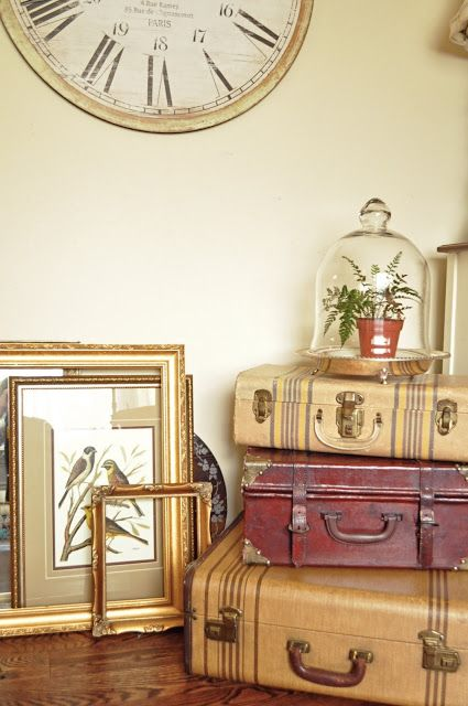 Cloche and vintage suitcases for display