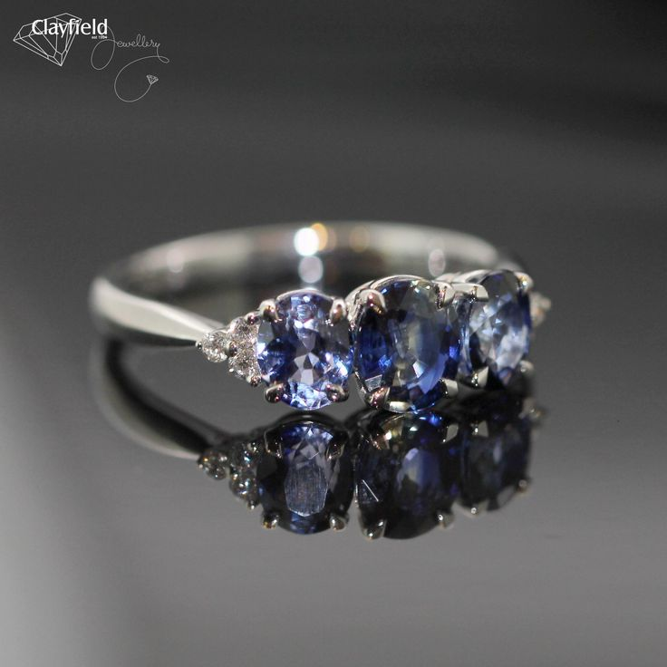 Stunning sapphire trilogy with a cluster of diamonds on the shoulder. #clayfieldjewellery