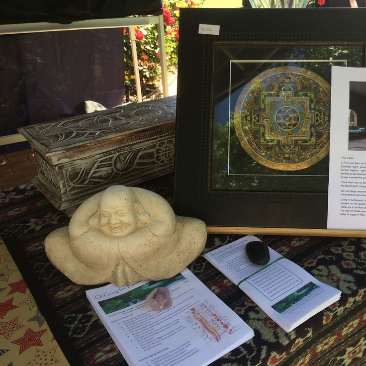 Set up at the market with framed mandala paintings - open for business