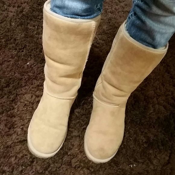 Tall UGG BOOTS for trade Great VERY gently worn condition no holes tears or stains. As pictured!  I took great care of these wore maybe 4 times because they were to BIG on me. listing for potential trades for Rock Revival Jeans sz 24 or 25 pr RR shorts OR pair of UGGS size 6. UGG Shoes