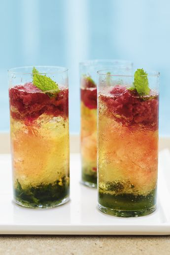 Impress friends and family with this stunning raspberry mojito. Start with a layer of mint leaves, lime juice and sugar, then half fill the glass with crushed ice. Pour over rum and layer crushed raspberries at the top. Top with soda and garnish with a sprig of mint. Find more Waitrose cocktail recipes on our website.