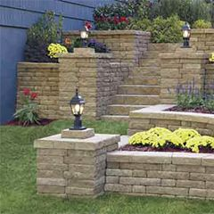 Used in both commercial landscaping and residential landscaping design, retaining wall blocks may be used to build something as simple as a raised planter or built dozens of feet tall to level a building site, create a parking area, or to stabilize a slope. Properly built walls can add to the beauty, functionality, and value of your property.