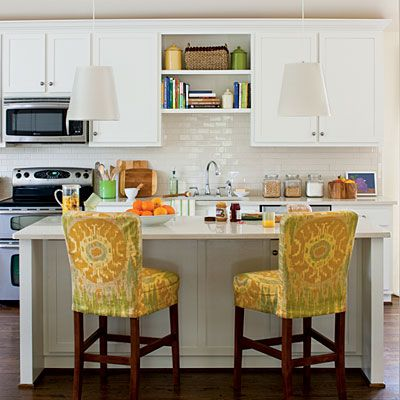 Kitchen makeover in all white! Love the fabric on the chairs.     Photo: Laurey W. Glenn