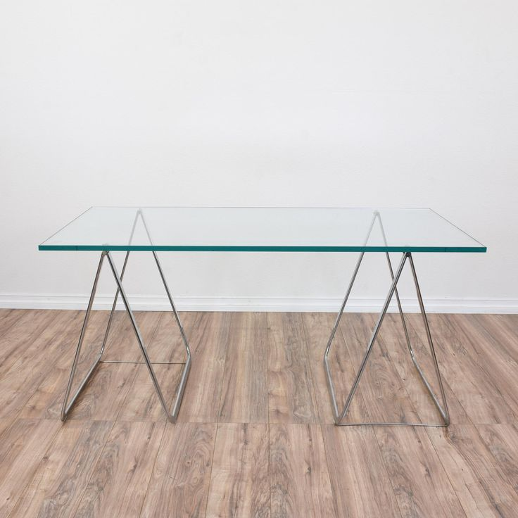 This minimal glass-top desk is complimented by chrome trestle legs. This would make a great multi-purpose surface for a small apartment--dining table or desk. In excellent vintage condition.  #contemporary #desks #executivedesk #sandiegovintage #vintagefurniture