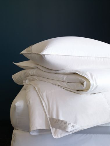 European white goose down with a lovely soft ticking, available in soft, medium, and firm in pillows and light-, medium-, and heavy-weight duvets. Indulge.
