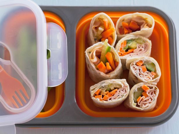 "Here's ""sushi"" you can pack in a lunchbox. Ree builds turkey and cream cheese wraps in soft flour tortillas, with carrot and cucumber for crunch, then cuts them into quarters to create ""rolls."""